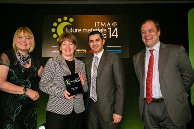 ITMA Future Materials Awards organizers present one of the awards won to Yvonne Engelen (left middle) and Shitij Chabba (right middle) from DSM Dyneema. (Photo ITMA, DYNPR297)