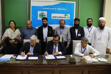 Mujtaba Rahim, CEO of Archroma Pakistan Limited, and Prof. Dr. Mohammad Aslam Uqaili, Vice Chancellor of Mehran University of Engineering & Technology signing documents of the Memorandum of Understanding signed at a ceremony held in Jamshoro, Pakistan. <br>(Photo: Archroma)