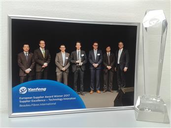 Donald De Deygere and Jefrem Jennard receiving the Yanfeng Automotive Interiors Supplier Excellence award. (Photo: © Beaulieu International Group)