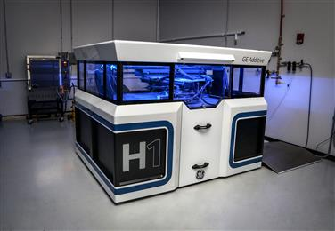 GE Additive reveals prototype of new binder jet machine.