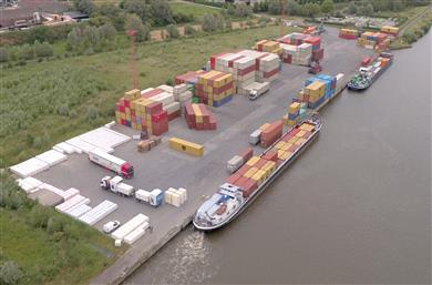 Sustainable container transport passing through the River Terminal Wielsbeke, B.I.G.'s global inland hub to the rest of the world. 