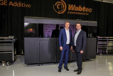 Jason Oliver President & CEO GE Additive with Philip Moslener product development leader Wabtec Corporation.