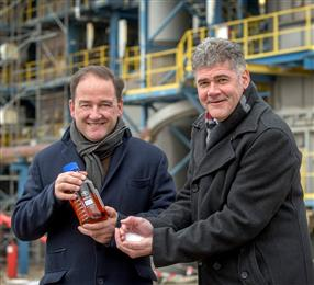 Jeroen Castelijn, General Manager Geleen site and Frank Kuijpers, General Manager Corporate Sustainability celebrate the certified circular polymers produced in the Netherlands.