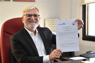 Mujtaba Rahim, CEO of Archroma, Pakistan, holding the memorandum of understanding signed between Archroma and the University. 