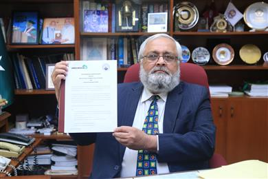 Dr. Sarosh Hashmat Lodhi, Vice Chancellor of NED University of Engineering & Technology in Pakistan, holding the memorandum of understanding signed between Archroma and the University. 